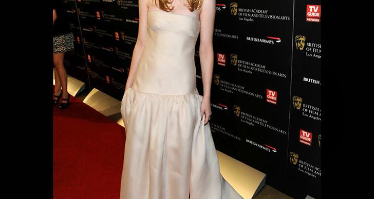 ... i ljusrosa klänning med släp.