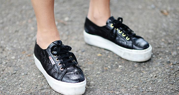 Här i skor från hennes egen kollektion.