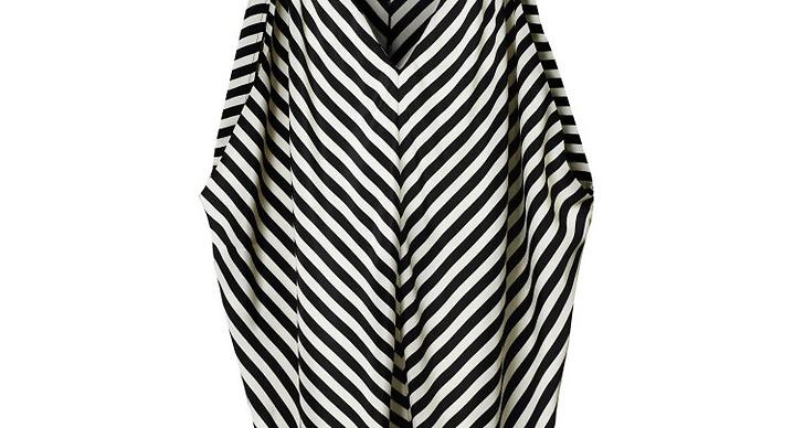 Grafiskt mönstrad tröja med öppna ärmar.