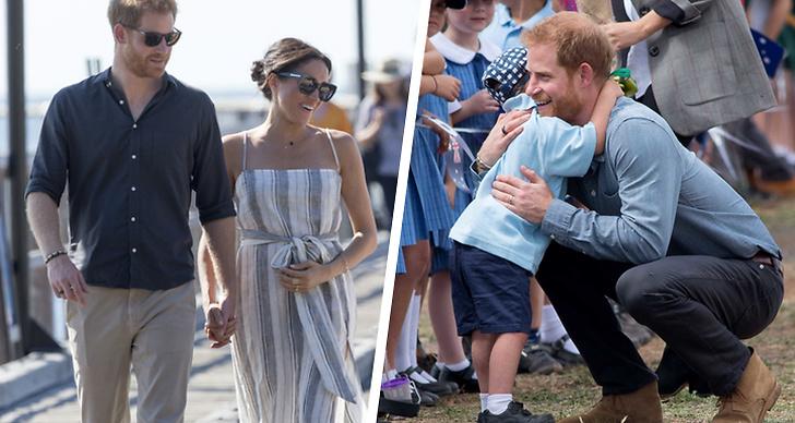 Prins Harry och Meghan Markle i Australien, prins Harry kramar om ett barn.